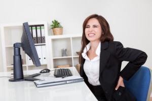 Businesswoman Having Backache At Work